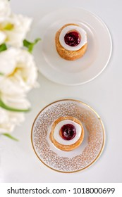 Set for 2. Runeberg's tart or cake is a Finnish traditional dessert and pastry, white tulips on the foreground.