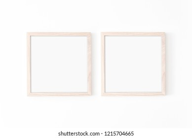 Set of 2 square wooden frame mockup on white wall. Poster mockup. Clean, modern, minimal frame. Empty fra.me Indoor interior, show text or product