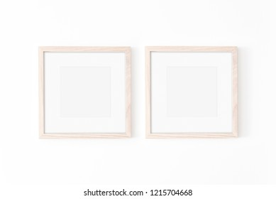 Set of 2 square Wooden frame mockup with passe-partout on white wall. Poster mockup. Clean, modern, minimal frame. Empty fra.me Indoor interior, show text or product