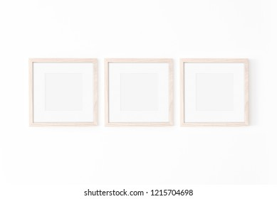 Set of 3 square Wooden frame mockup with passe-partout on white wall. Poster mockup. Clean, modern, minimal frame. Empty fra.me Indoor interior, show text or product
