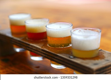 Set of 4 glasses for testing beer. Close-up. Different types of beer.