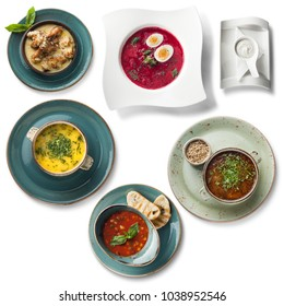 Set of 5 delicious soups: chicken soup, okroshka, chicken bouillon, cabbage soup (shchi), bean soup, all isolated on white