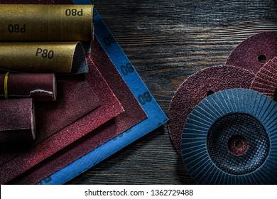 set of abrasive tools on vintage wood background