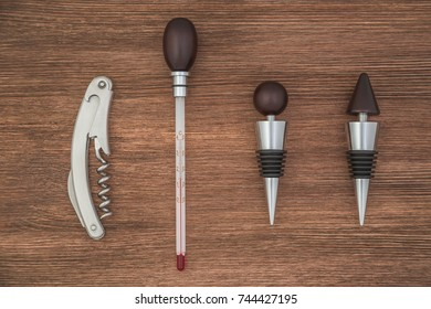 Set of accessories for wine on brown background