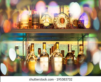 Set of Alcohol bottles on the wall with Bokeh