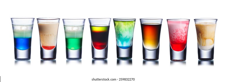 Set of alcoholic cocktails in shot glasses (shooters) isolated on white