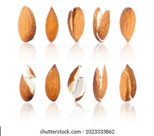 Set of almonds in different positions close-up, isolated on white background