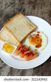Set of american breakfast on wooden table.