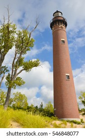 Set amongst the trees and dunes on the west coast of Michigan, stands the Little Sable Point Lighthouse