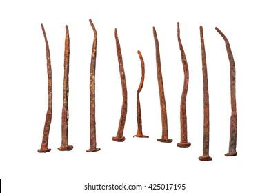 set of antique Rusty Nails, laid out in a row on a white background