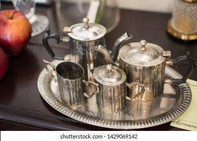 set of antique Stainless steel jar and cup on a silver plate