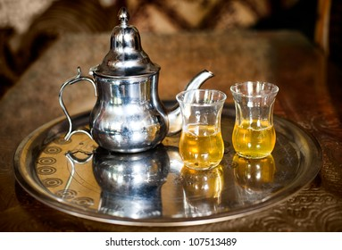 Set of arabic nana mint tea with metal tea pot and glasses