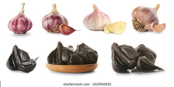 Set with aromatic black (Allium sativum) and white garlic bulbs on white background