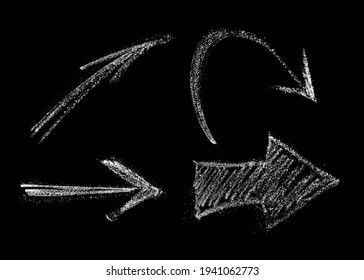Set Of Arrows Drawn In Chalk. Isolate on A Black Background. Hand-drawn design element.