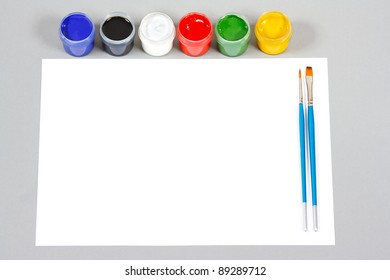 Set of art gouache paints and brushes to paint and paper