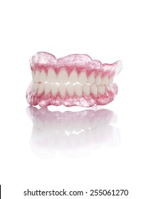 A Set of Artificial Dentures Isolated on White Background