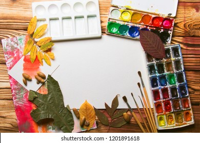Set of artist accessories collection with autumn leaves. Canvas for painting, art brushes, palette. Top view