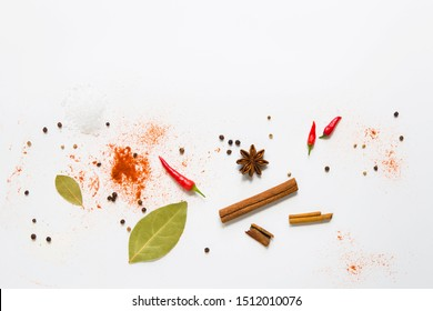 set of assorted colorful spices on a white background, flat lay, top view, with copy spice