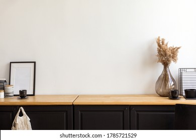 Set of assorted decorations and accessories placed on cupboard against white wall in cozy room at home