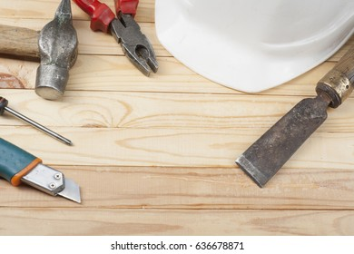 Set of assorted work tools and white helmet on the table. Construction concept.Copy space for text.