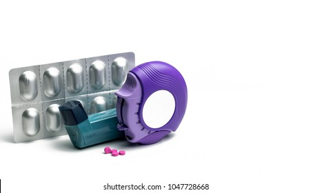 Set of asthma inhaler, accuhaler and anti-allergy pills for treatment asthma. Asthma controller, reliever equipment on white table with copy space. Bronchodilator and steroids drug for severe asthma.