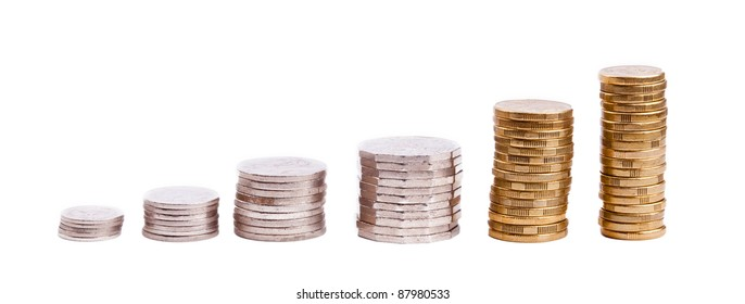 Set of Australian coin currency in stacks, including 5, 10, 20 and 50 cent coins, plus 1 and two dollars, isolated on white
