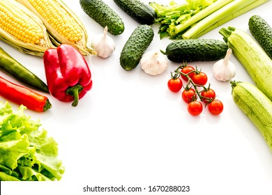 Set of autumn vegetables - potato, cucumber, carrot, greenery - on white background copy space