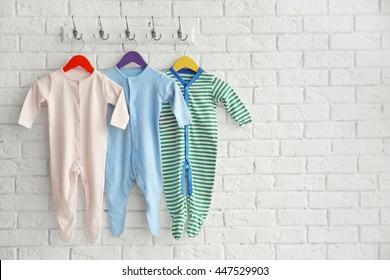 Set of baby romper on brick wall