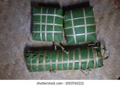 "Set of ""Banh Chung"" or Chung cake put on flat winnowing basket"