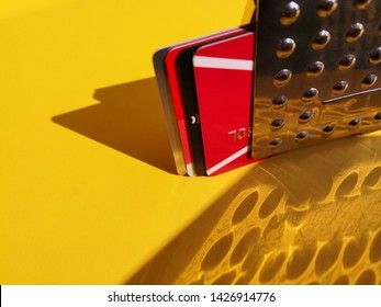 Set of bank cards and discount card with hidden embossed number stored in metal container. Protective card holder for security reasons. Protection of confidential personal financial information.