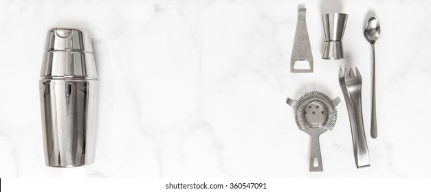 Set of bar accessories for cocktail making. Shaker, jigger, strainer, spoon