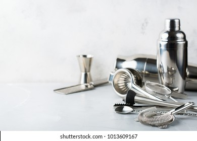 Set of bar tools for cocktails, accessories and utensils for bartender for making alcohol beverage, shot and long drink. Copy space background