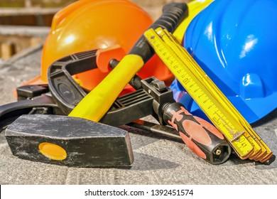 Set of basic construction tools and hard hats