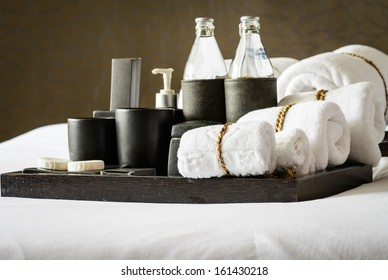 Set of bath accessories on bed