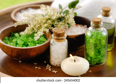 A set of Bath salt on the wooden table. Asian spa massage.