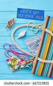 Set of beach clothing, handbag. Summer fashion look, vertical image.
