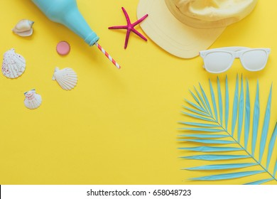 set for a beach sea holiday: cocktail or lemonade in the bottle, cap and sunglasses