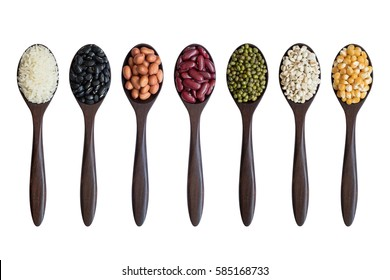 set of beans,peas,lentils,corns,rices on wooden spoons isolated on white background
