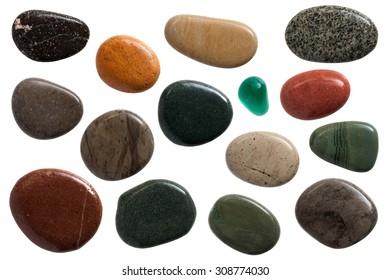 set of beautiful sleek pebble stones, close up on white background