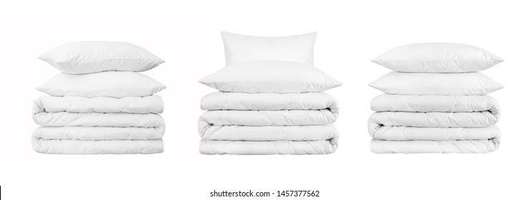 Set of beddings stacks on the white background. Two white pillows on the stacked duvet isolated. Collection of bedding objects isolated against white background. Bedding items catalog illustration.