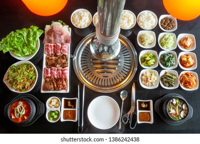 Set of beef ready for grill on stove serve with vegetable,soup and rice and slide dish, Korean style barbecue.