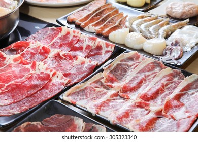 Set of beef and seafood for Sukiyaki or Yakiniku (Japanese Food)