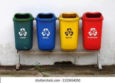 set of bins for the selective collection of waste (glass, paper, metal and plastic) for recycling purposes