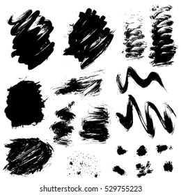 Set of black blots and ink splashes isolated on white background. Abstract elements for design in grunge style.