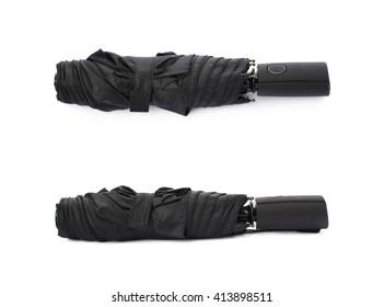Set of Black folded umbrella isolated over the white background