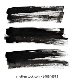 Set of black ink brush strokes isolated on the white background