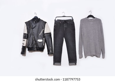 Set of black leather punk rivets with jacket with jeans and sweater