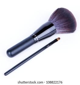 Set of black make-up brushes on white background