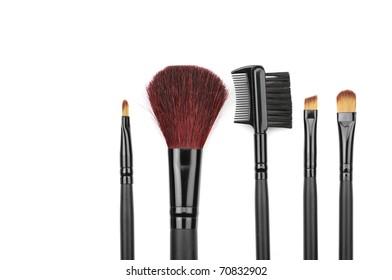 Set of black make-up brushes on white background.