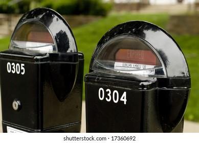 A set of black parking meters